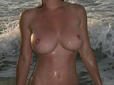 Intimate Nude Photo of Mature Woman at the Sea