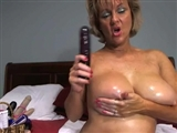 Busty Oiled Granny Getting Naked and Fucking Her Big Pussy
