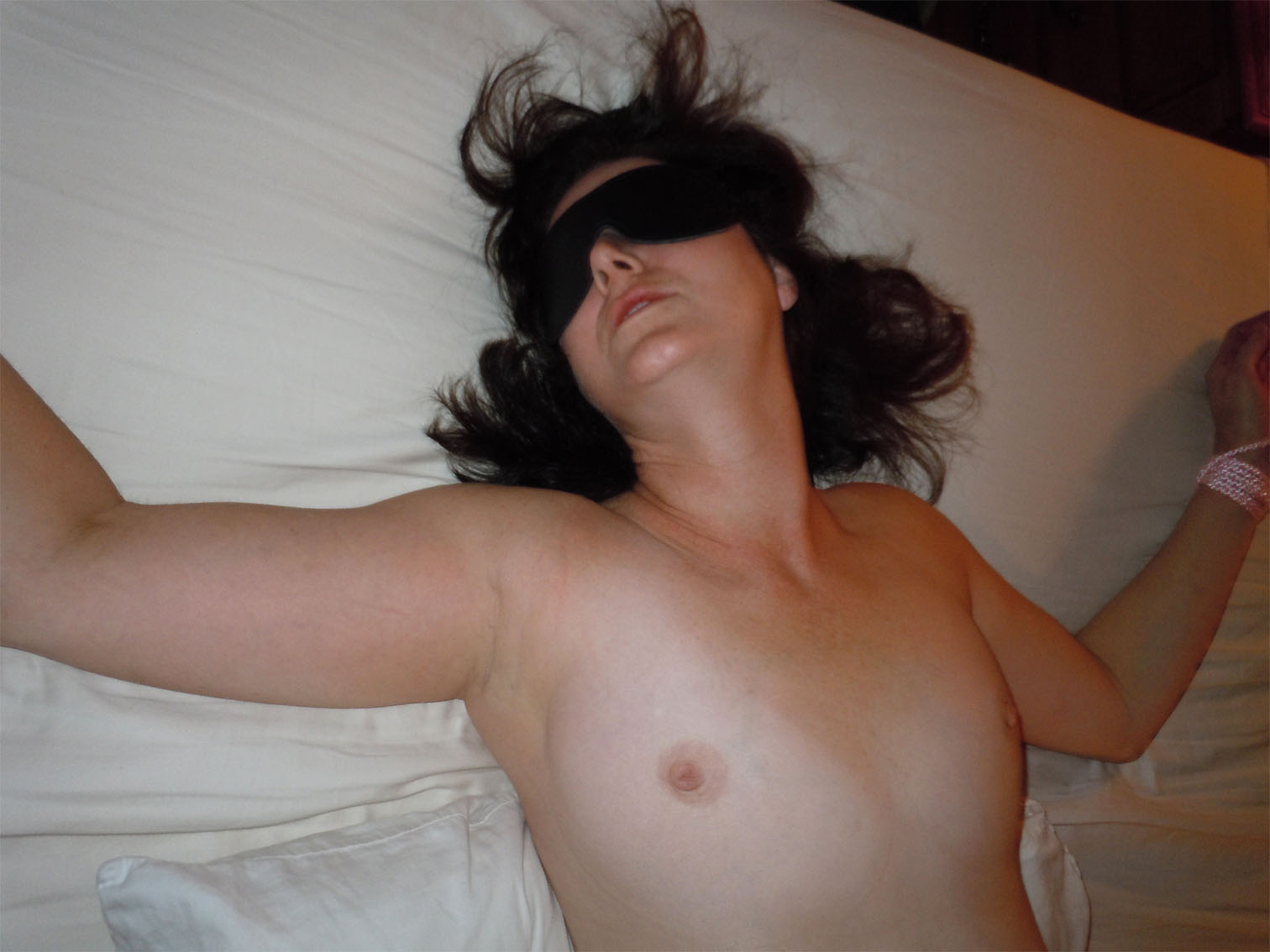 Blindfolded amateur brunette