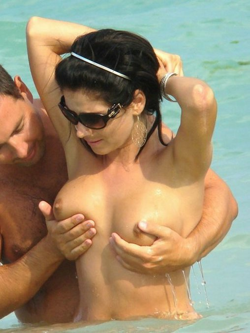 Horny Husband Touches Breasts of Wife in Sea at Beach Photo