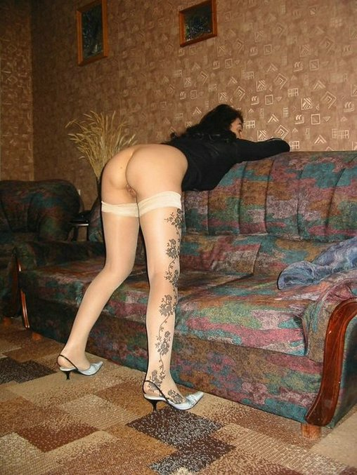 Mature Russian Lady Posing with Sexy Ass on Photo