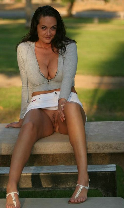 Brunette Lady Flashes Pussy on Public Bench Photos