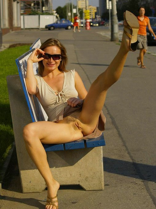 Kinky Wife Flashes Pussy in a Public Street Place Photos