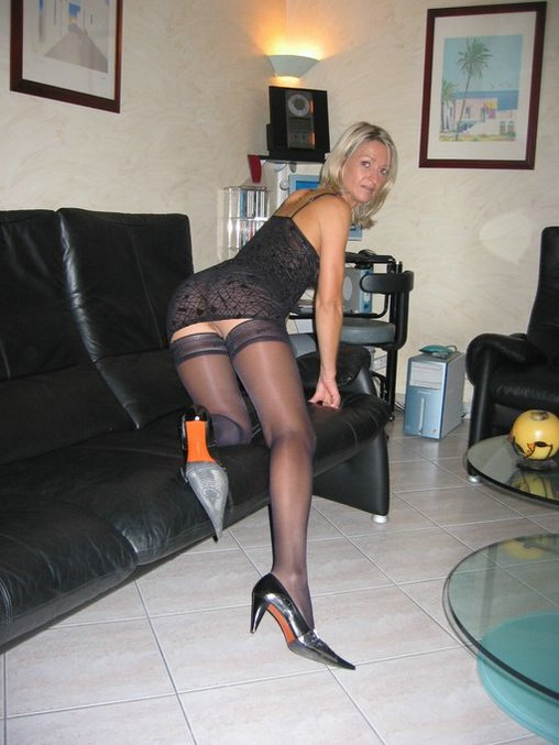 Super Sexy Blonde Wife Bends in Stockings on Couch Photos