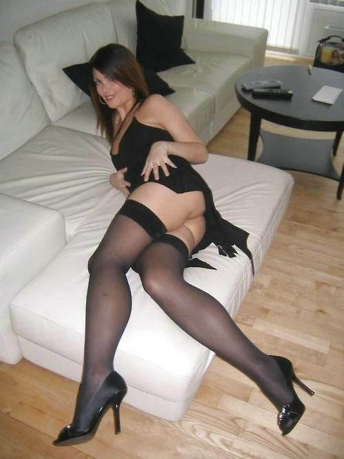 Amateur naked photo of mature lady in black stockings and skirt.