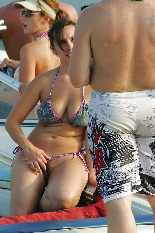 Pictures of mature wife in public flashing of pussy at the beach.