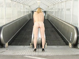 Sexy Woman Posing Nude on Automatic Stairs of Airport Photo