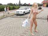 Young Wife Strips Off Clothes on Public Road Photo