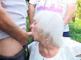 Slut Granny Sucking many Dicks Outdoor
