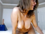 Stunning MILF totally naked on webcam playing with pussy